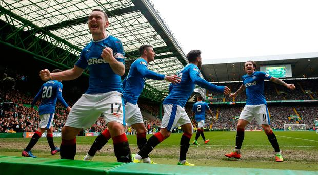Rangers' Lee Hodson celebrates towards the crowd after a late Clint Hill equaliser at Celtic Park. Photo: REUTERS