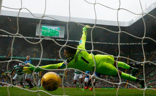 A strike from Celtic's Stuart Armstrong flies past Rangers' Wesley Foderingham. Photo: REUTERS
