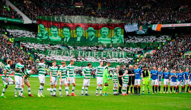 Celtic and Rangers players shake hands before kick-off. Photo: Jeff Holmes/PA Wire