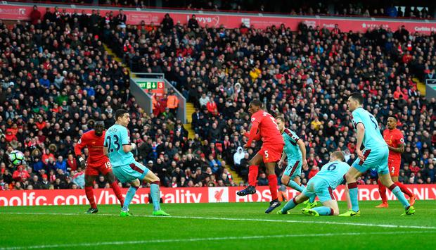 Burnley defender Stephen Ward can't prevent Georginio Wijnaldum from netting Liverpool's opening goal. Photo: Michael Regan/Getty Images