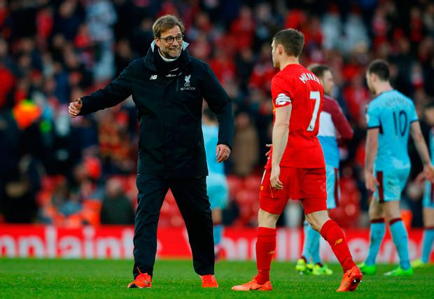Liverpool manager Juergen Klopp and James Milner celebrate after the game. Photo: Reuters / Phil Noble