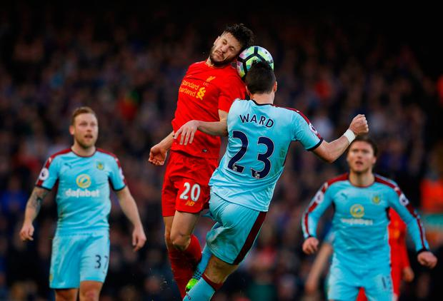 Liverpool's Adam Lallana and Burnley's Stephen Ward collide in mid-air. Photo: Reuters / Phil Noble
