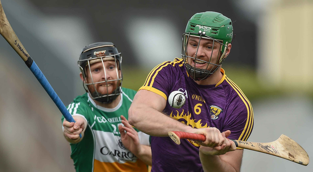 Wexford's Matthew O'Hanlon in action against James Mulrooney. Photo: David Maher/Sportsfile