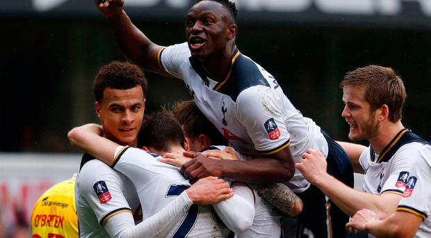 Christian Eriksen is swamped by teammates after giving Tottenham the lead at White Hart Lane. Photo: Reuters / Eddie Keogh