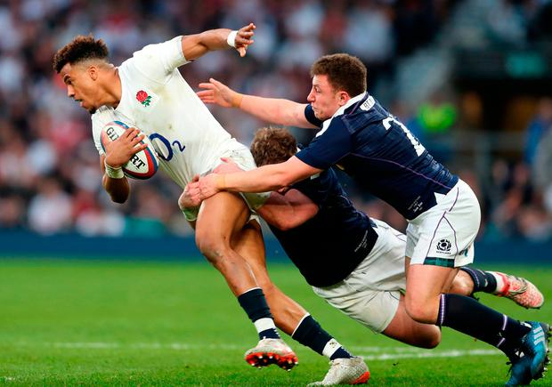 England's Anthony Watson is tackled by Scotland's Alex Dunbar and Duncan Weir during the RBS Six Nations match at Twickenham. Photo: David Davies/PA