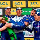 Ireland's Daniel Martin is held aloft by his QuickStep Floors team-mates after his third-place finish in Paris-Nice yesterday. The QuickStep team were also celebrating their best team award. Photo: Getty Images