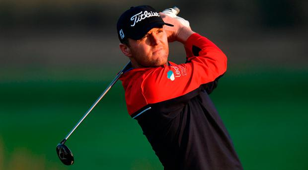 Michael Hoey of Northern Ireland plays a shot during the continuation of the delayed third round at the Hero Indian Open. Photo: Stuart Franklin/Getty Images