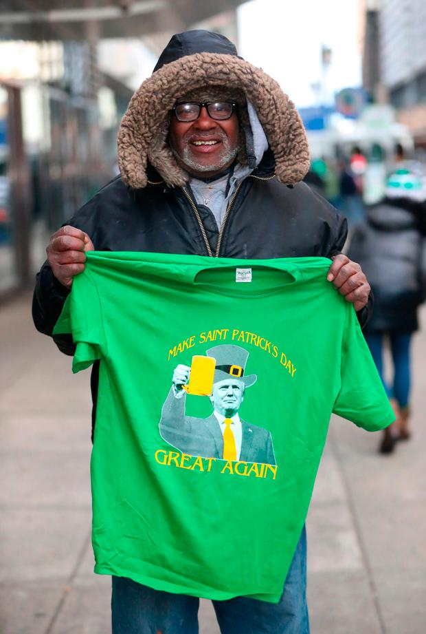 A man sells Trump-themed St Patrick's Day T-shirts in Philadelphia at the parade Picture: PA