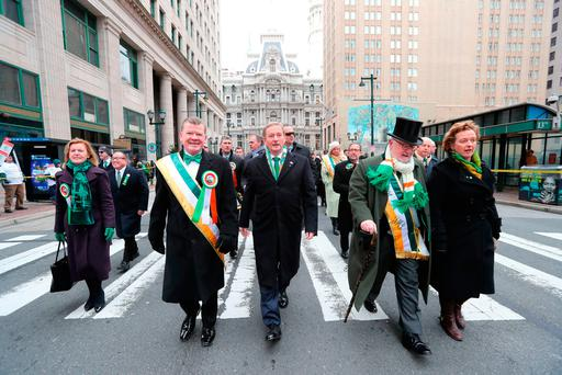 Taoiseach Enda Kenny walks in the annual St Patrick's Day parade in Philadelphia yesterday, as part of his US visit. Photo: Niall Carson
