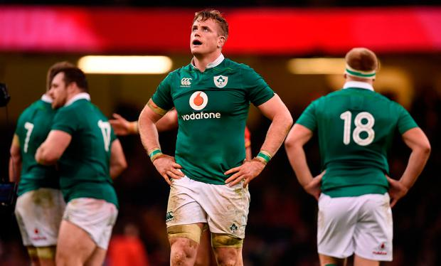 Ireland players look dejected after the RBS Six Nations at the Principality Stadium, Cardiff. Photo: Joe Giddens/PA Wire