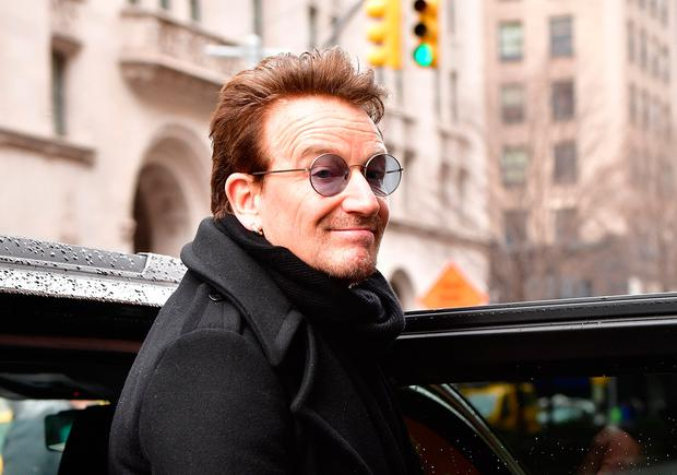 Bono leaves Upland restaurant on March 10, 2017 in New York City. (Photo by James Devaney/GC Images)