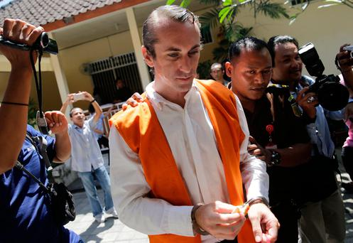British national David Taylor is escorted into a courtroom for the verdict in his trial over the death of a police officer at the Denpasar District Court in Bali, Indonesia March 13, 2017. REUTERS/Agung Parameswara