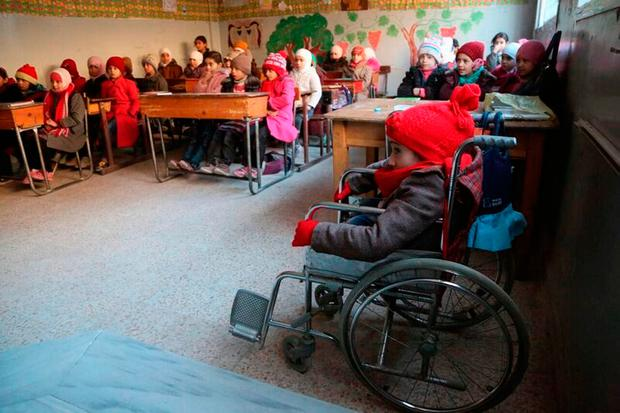 Maysam, 10, (right) who suffers from a birth spine defect, as more children were killed in the Syrian conflict in 2016 than in any previous year of the war since records began, Unicef figures show. UNICEF/Amer Alshami/PA Wire