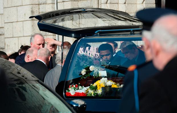 Sean Patel, partner of Annmarie O'Brien, amongst those taking her coffin from hearse to church. Funeral of victims of Clondalkin fire. St. Anne's Church, Shankill, Dublin. Picture: Caroline Quinn