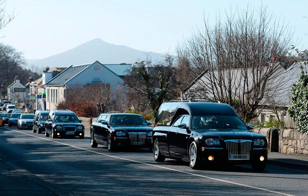 General view of procession with three hearses making way to the church for funeral mass. Funeral of victims of Clondalkin fire. St. Anne's Church, Shankill, Dublin. Picture: Caroline Quinn