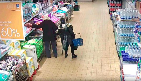 Undated handout CCTV still issued by West Midlands Police of Margaret Johnson (right) - dubbed the Pickpocket Queen of Birmingham - stealing from a handbag at an Aldi store in Castle Bromwich.Photo: West Midlands Police/PA Wire