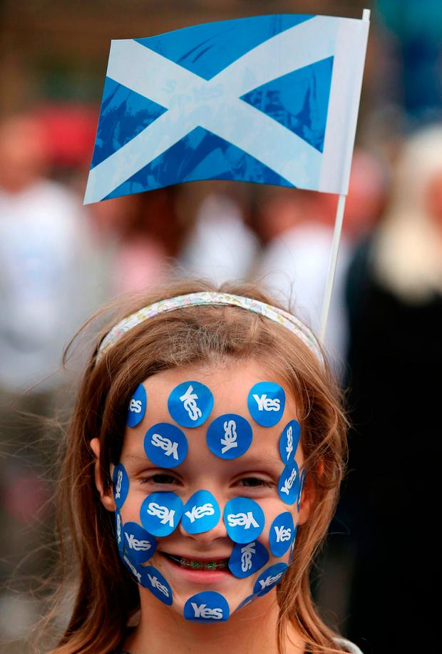 Rosie Gordon, 10, at a rally in George Square in Glasgow Credit: Andrew Milligan/PA Wire