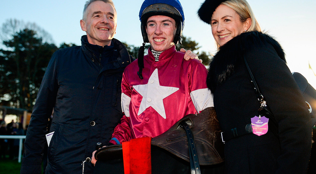 Jack Kennedy, centre, with owner Michael O'Leary, left, and his wife Anita, right, after winning the Lexus Steeplechase on Outlander during day three of the Leopardstown Christmas Festival in Leopardstown, Dublin. Photo by Seb Daly/Sportsfile