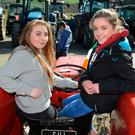 Rebecca Foley and Elen Nyhan at a tractor run at Belgooly Co Cork in aid of a new running track for Kinsale community college. Photo: Denis Boyle