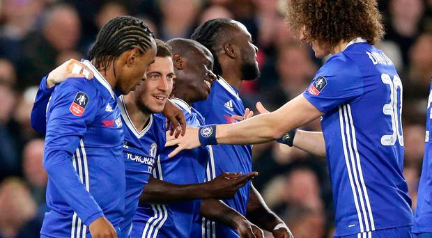 Chelsea's N'Golo Kante, centre, is congratulated by teammates