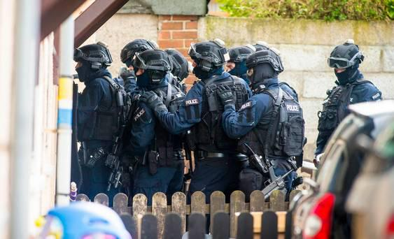 Officers from the SFO unit storm a house in the Woodburn area following a shooting in the area on March 13th 2017 (Photo - Kevin Scott / Belfast Telegraph )