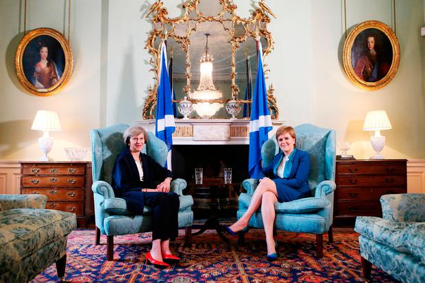 British Prime Minister Theresa May (left) meets with Nicola Sturgeon at Bute House in Edinburgh. Photo: Andrew Milligan/PA Wire