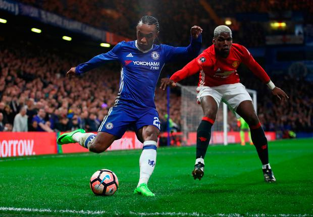Willian is closed down by United's Paul Pogba. GETTY