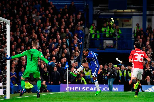 Willian has an unsuccessful shot towards David de Gea's goal. GETTY