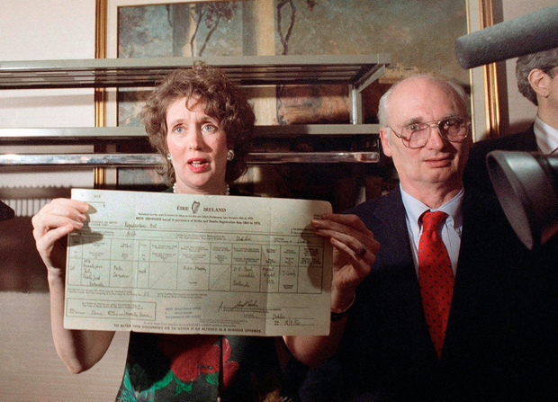 Annie Murphy with her partner Arthur Pennell as she holds up her son's birth certificate following a news conference in New York City. Photo: AP