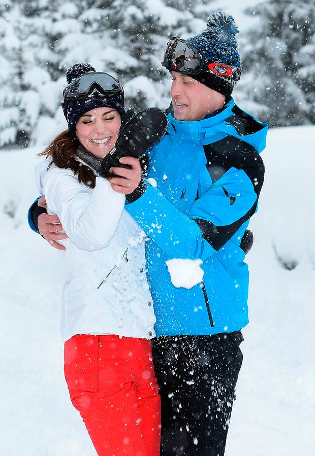 Prince William, Duke of Cambridge (R) and Catherine, Duchess of Cambridge (L) laugh after the Duchess threw a snowball at Prince William during a private break skiing at an undisclosed location in the French Alps on March 3, 2016.