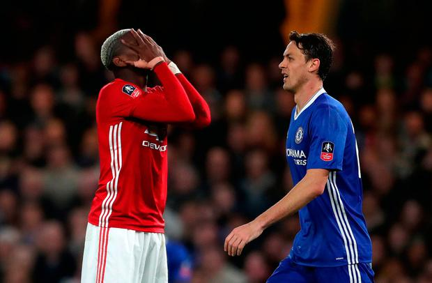 Manchester United's Paul Pogba (left) looks dejected during Chelsea defeat