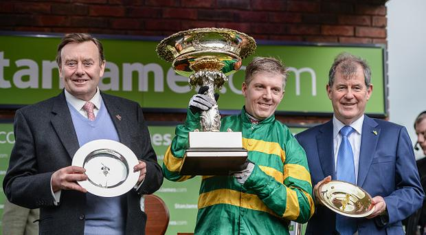 Cheltenham , United Kingdom - 14 March 2017; Trainer Nicky Henderson, left, jockey Noel Fehily, centre, and owner JP McManus after winning the Stan James Champion Hurdle Challenge Trophy with Buveur D'Air during the Cheltenham Racing Festival at Prestbury Park, in Cheltenham, England. (Photo By Seb Daly/Sportsfile via Getty Images)