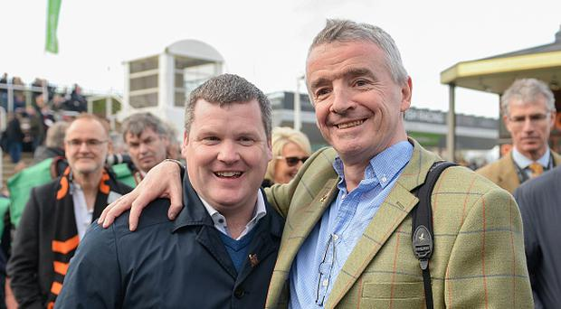 Cheltenham , United Kingdom - 14 March 2017; Trainer Gordon Elliott, left, with owner Michael O'Leary after winning the OLBG Mares' Hurdle with Apple's Jade during the Cheltenham Racing Festival at Prestbury Park, in Cheltenham, England. (Photo By Seb Daly/Sportsfile via Getty Images)