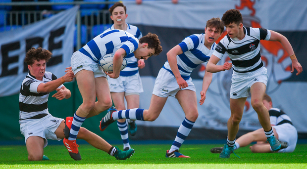 Michael Lowey of Blackrock is tackled by Belvedere's Fergal O'Byrne. Photo: David Fitzgerald/Sportsfile