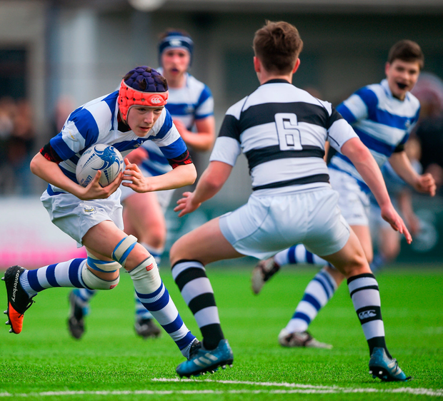 Adam Simpson of Blackrock College is tackled by Eoghan Rutlege of Belvedere College. Photo by David Fitzgerald/Sportsfile