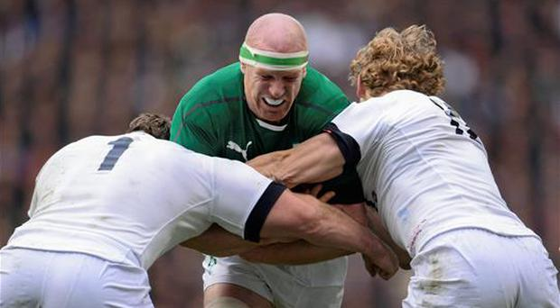 22 February 2014; Paul O'Connell, Ireland, is tackled by Joe Merler, left, and Billy Twelvetrees, England. RBS Six Nations Rugby Championship, England v Ireland, Twickenham Stadium, Twickenham, London, England. Picture credit: Stephen McCarthy / SPORTSFILE