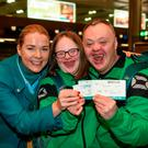 Aer Lingus cabin crew member Susan Keogan with Laoise Kenny, a member of Kilternan Karvers Special Olympics Club, from Monkstown, Co Dublin, and Cyril Walker, a member of Ski Ability Special Olympics Club, from Markethill, Co Armagh Photo: Ray McManus/Sportsfile