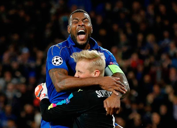 Leicester City's Kasper Schmeichel celebrates with Wes Morgan after saving a penalty. Photo: Reuters
