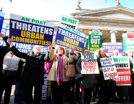 Members of the Irish Postmasters' Union protesting outside the GPO in Dublin yesterday Photo: Tom Burke