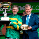 Jockey Noel Fehily with the Stan James Champion Hurdle Challenge Trophy, and owner John McManus Photo: David Davies/PA Wire