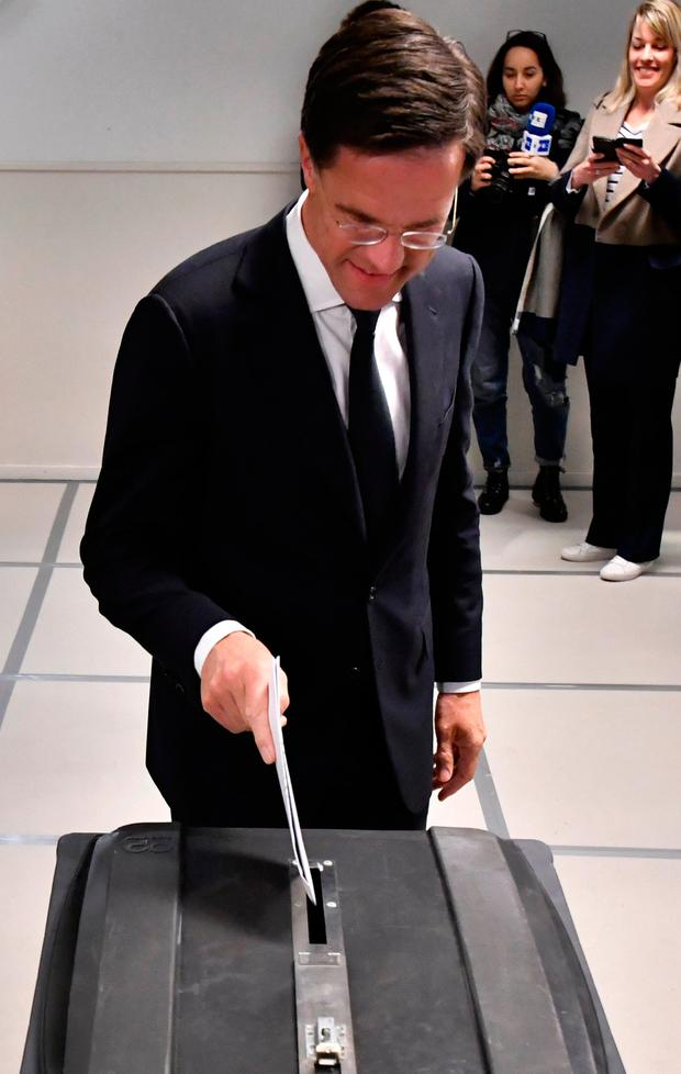 Dutch Prime Minister Mark Rutte casts his vote for the Dutch general election in The Hague, Netherlands, Wednesday, March 15, 2017. (AP Photo/Patrick Post)