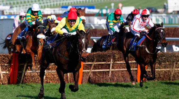 Supasundae ridden by Robbie Power lead the field over the final flight before going on to win The Coral Cup Handicap Hurdle Race run during Ladies Day of the 2017 Cheltenham Festival at Cheltenham Racecourse. PRESS ASSOCIATION Photo. Picture date: Wednesday March 15, 2017. Photo credit should read: Julian Herbert/PA Wire.