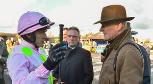 Naas , Ireland - 5 February 2017; Jockey Ruby Walsh, left, in conversation with trainer Willie Mullins after sending out Douvan to win the BoyleSports Tied Cottage Steeplechase at Punchestown Racecourse in Naas, Co. Kildare. (Photo By Ramsey Cardy/Sportsfile via Getty Images)