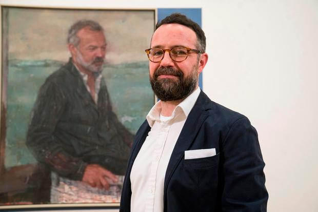Gareth Reid with his portrait of Graham Norton