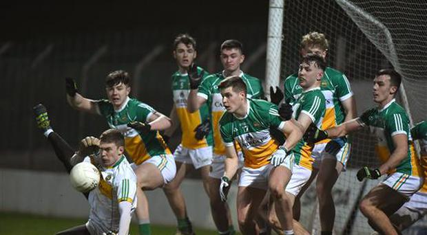 15 March 2017; Jack Egan, 17, of Offaly and his team-mates block a late free from Laois during the EirGrid Leinster GAA Football U21 Championship Semi-Final match between Offaly and Laois at Netwatch Cullen Park in Carlow. Photo by Matt Browne/Sportsfile