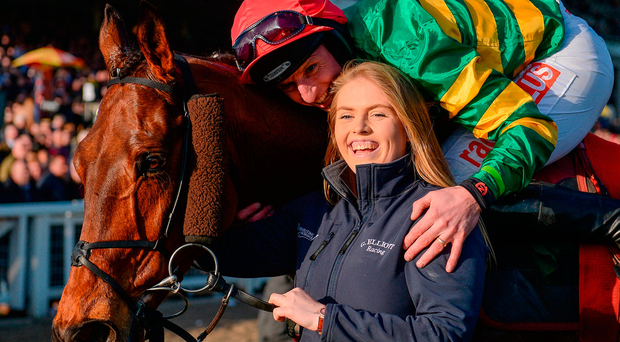 Jockey Jamie Codd with stable hand Georgie Benson after winning with Cause Of Causes yesterday and the JP McManus colours may well be in the winner's enclosure again today. Photo by Seb Daly/Sportsfile