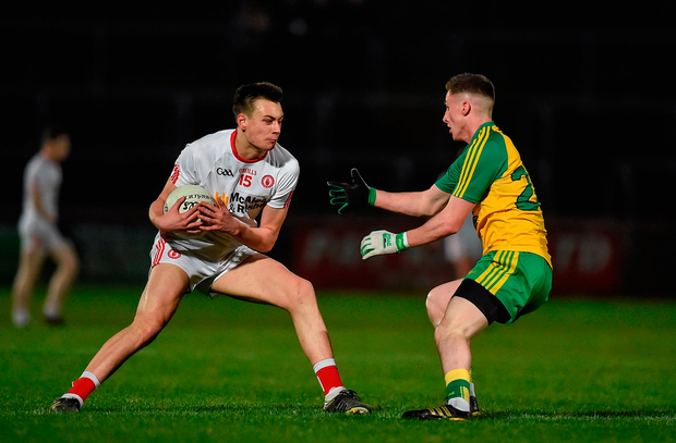 Paul Donaghy of Tyrone in action against Emmett McNabb of Donegal. Photo: Philip Fitzpatrick/Sportsfile