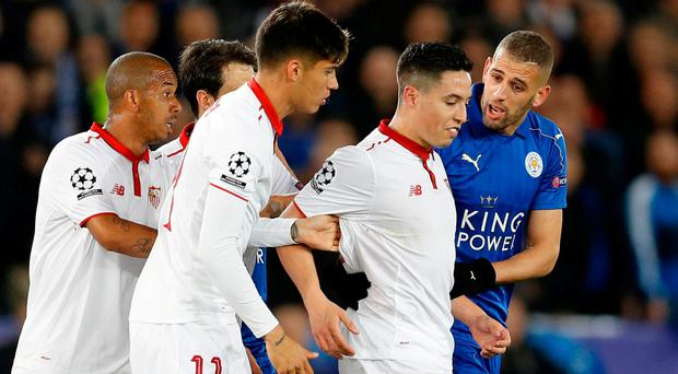 Sevilla's Samir Nasri is spoken to by Islam Slimani as he attempts to confront Leicester City's Jamie Vardy after Nasri is sent off. Photo: Darren Staples/Reuters
