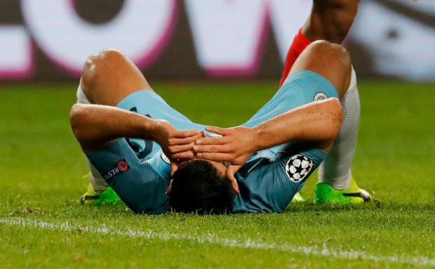 Manchester City's Sergio Aguero reacts after a missed chance. Photo: Eric Gaillard/Reuters