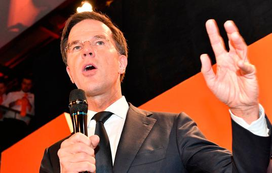 Prime Minister Mark Rutte of the free-market VVD party speaks to his supporters after exit poll results of the parliamentary elections were announced in The Hague, Netherlands, Wednesday, March 15, 2017. (AP Photo/Patrick Post)